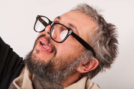 grumpy old man: Old grumpy man with beard and big nerd glasses