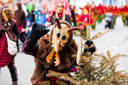 Seelbach, Germany - February 4, 2018: An ant by Masquerade Festival called Narrenumzug. It is a carnival in southern Germany in the period of traditional german celebration called Fasnacht. Event happens every year. It is an old tradition for germans. Peo