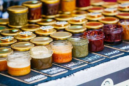 jars of spices bio honey at farmers food market Stock Photo