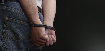 arrested criminal: Justice