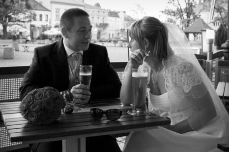 Bride and groom - outdoors cafe photo