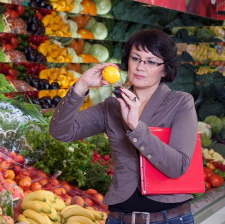 The quality control of fruit and vegetables in a shop photo