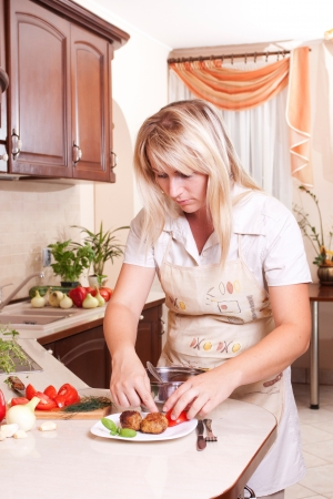 A woman cooking dinner in the kitchen. Healthy Eating