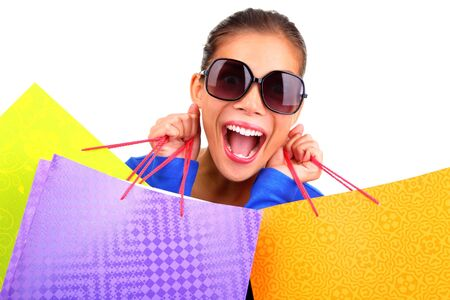 shopper: Crazy young woman on a shopping spree. Isolated on white background.