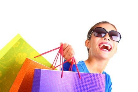 happy shopper: Beautiful young adult laughing having fun on a shopping day. Isolated on white background.