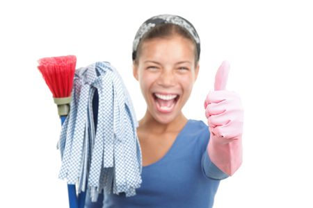 cleaning background: Woman finished cleaning showing a happy thumbs up after a succesful spring cleaning. Beautiful mixed race asian  caucasian model isolated on white background. Shallow depth of field with focus on the thumb.