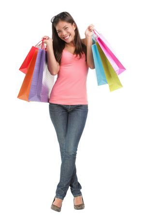 body bag: Full length attractive shopping girl excited about her purchases. Isolated on white background. Stock Photo