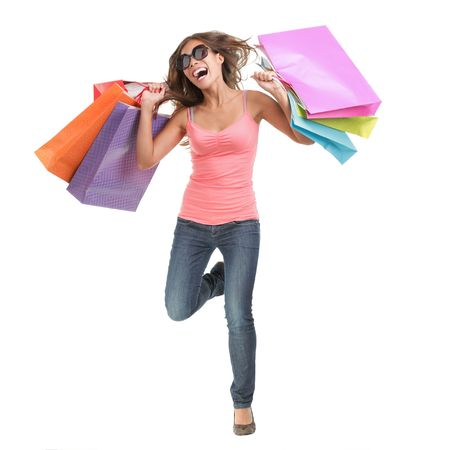 Cheerful young woman running of happiness after a shopping spree. Full body isolated on white background.