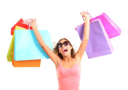 or spree: Shopping woman very excited. Dynamic picture of young woman on a shopping spree with lots of bags. Isolated on white background.
