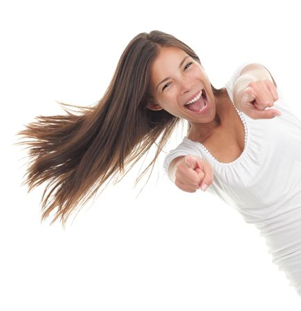 Pointing happy girl screaming of joy and coming from the side. Isolated on white background. photo