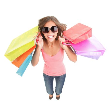 Shopping woman excited and happy. Dynamic and funny image of very hot young woman with shopping bags jumping in full length. Isolated on white background. photo