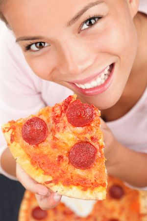 take away: Pizza woman. Woman eating a slice of pepperoni pizza. Beautiful mixed race chinese  caucasian model.