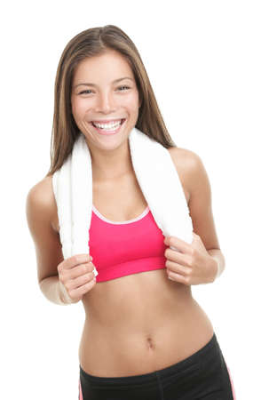 Asian fitness woman with towel around her neck. Gorgeous mixed race chinese  caucasian model isolated on white background. photo