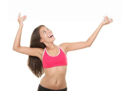 Fitness woman showing white billboard sign. Gorgeous smiling and energetic mixed race chinese  caucasian model isolated on white background.