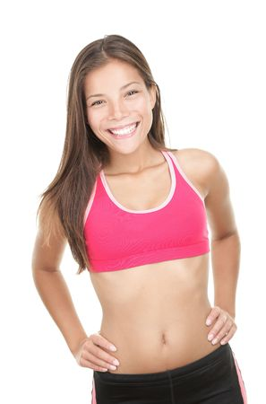 Fitness girl. Cute happy and confident fitness woman smiling at camera. Adorable mixed race chinese / caucasian model isolated on white background. Banco de Imagens - 6305258