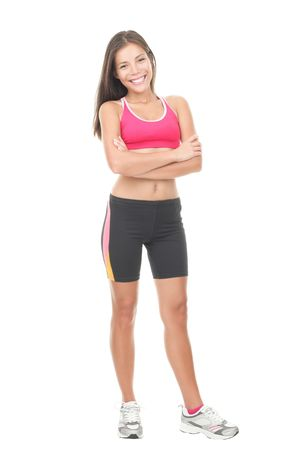 Fitness woman. Smiling happy asian fitness girl in full length. Gorgeous smiling mixed race chinese  caucasian model isolated on white background. photo
