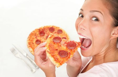 Pizza woman eating a slice having fun.
