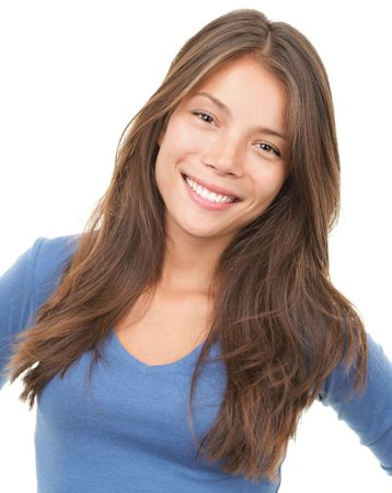 multi race: Multiracial woman smiling looking at camera wearing blue blause. Mixed chinese  caucasian female model isolated on white background.