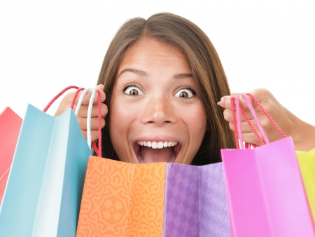 elation: Shopping woman excited.