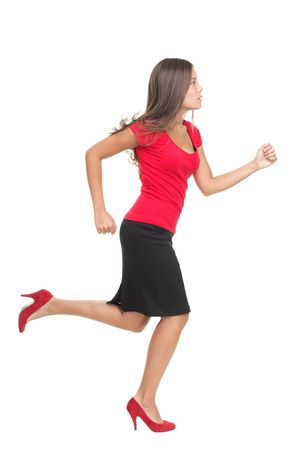 Businesswoman running isolated. Cutout of beautiful business woman casual dressed in red running in high heels in profile in full length. Isolated on white background.
