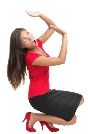 Business Woman defending herself under pressure from something...Work load or too much weight on her shoulders. photo