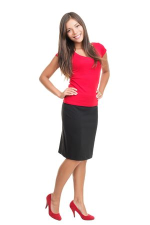 full face: Isolated portrait of woman in full length. Cutout of beautiful young business woman casual dressed in red standing in high heels. Full length image of cute mixed race caucasian  chinese young woman isolated in full length cutout on white background.