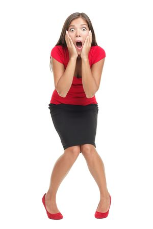 surprised: Shocked and surprised businesswoman isolated in full length. Beautiful mixed race caucasian  chinese young woman standing with open mouth holding her head in surprise. Isolated on white background. Stock Photo