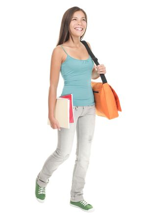 person walking: Female student walking in full length. Woman College student in her early 20s walking and smiling. Cutout of young beautiful multiracial chinese  caucasian model isolated on white background. Stock Photo