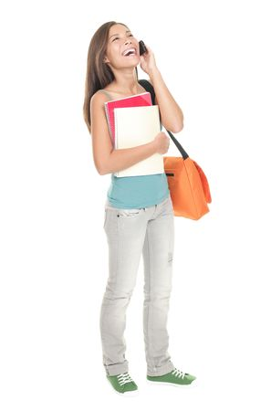 woman on phone: Woman college student standing isolated in full length. Mixed race Asian Chinese  caucasian. Female university student talking in mobile phone. Cutout isolation on white background.  Stock Photo