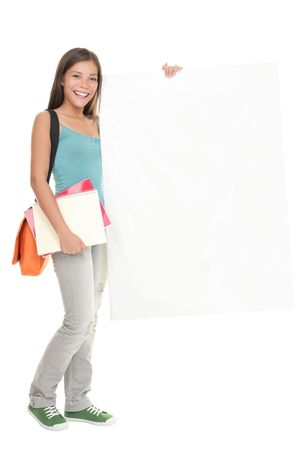 Blank sign student. Female college  university student standing holding white blank billboard sign. Full length picture of a beautiful multiracial chinese  caucasian young woman model isolated on white background. photo