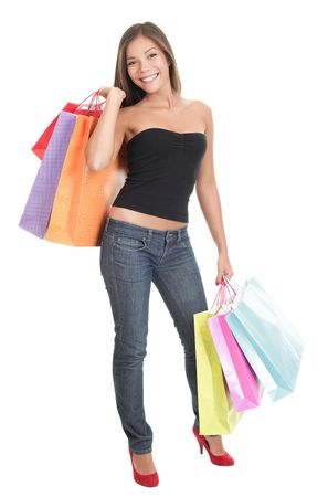shopper: Shopping woman isolated in full length on white background. Gorgeous multiracial Chinese Asian  Caucasian young woman model in her twenties.  Stock Photo