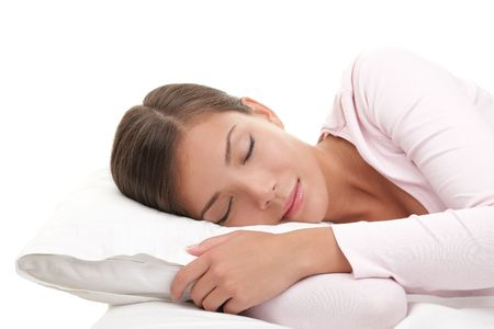 sleeping woman: Woman sleeping isolated on white background.