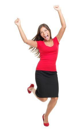 Erfolg  Gewinner Frau. Casual junge erfolgreiche geschäftsfrau springen sehr aufgeregt. Im vollen Körper auf weißem hintergrund isoliert.