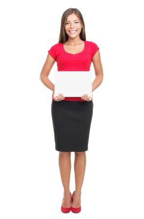 skirt suit: Woman holding sign isolated. Full body image of young beautiful multiracial woman holding blank sign. Isolated on white background.
