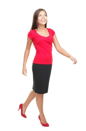 person walking: Woman walking isolated on white. Full body image of a beautiful mixed Chinese Asian  Caucasian young woman model in her twenties.