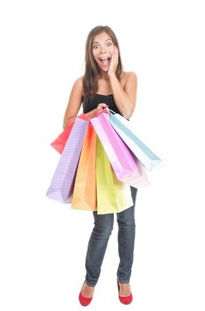 donna entusiasta: Shopping donna eccitata isolata su sfondo bianco in piena lunghezza.