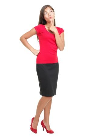 Thinking woman isolated on white background in full body / length. Beautiful young mixed race Asian / Caucasian business woman being pensive looking up Stock Photo - 6959499