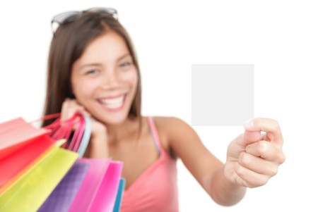 Shopping woman showing sign or blank card. Chinese Asian  Caucasian isolated on seamless white background. Focus on the blank sign  card.  photo