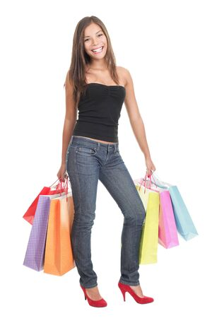 Woman shopper shopping standing on white background. photo