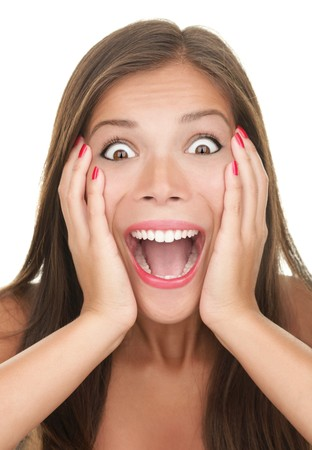 Funny surprised expression on a young womans face. Asian caucasian person. Imagens