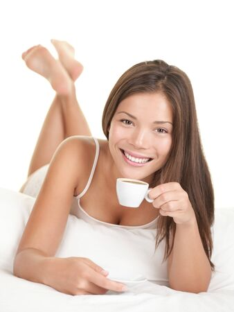 Coffee woman in bed. Woman in bed drinking espresso coffee in the morning. Isolated on white background. photo