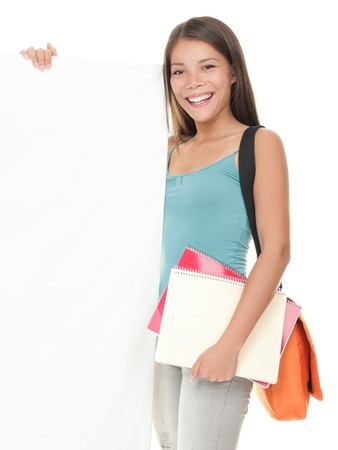 Student sign. Smiling beautiful college university student showing blank empty billboard sign. Beautiful young mixed race Asian  Caucasian woman isolated on white. 版權商用圖片