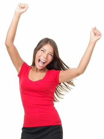 excitment: Mujer de ganador, celebrando el éxito aislado sobre fondo blanco.  Foto de archivo