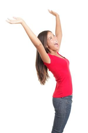 Vieren van succes. Jonge succesvolle vrouw in vreugdevolle viering. Profiel te bekijken op een witte achtergrond. Prachtige Chinese  white Kaukasische vrouwelijke model.