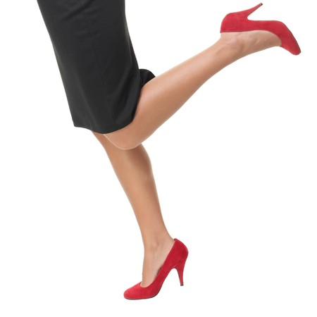 skirts: Woman legs running in red high heels - closeup. Stock Photo