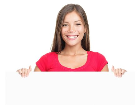banner ads: Billboard sign woman smiling. Casual business woman showing blank white placard Young Asian  Caucasian female model isolated on white background. Stock Photo