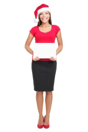 Santa woman showing sign standing in full body isolated wearing santa hat. Mixed Asian / Caucasian model. Stock Photo - 7989987