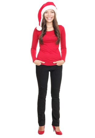 Casual christmas woman smiling standing with Santa hat isolated in full length. Asian Chinese / white Caucasian young woman on white background. Stock Photo - 8153460