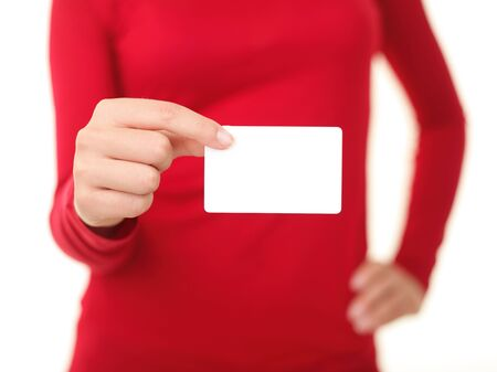giving gift: Person holding business card. Blank white business sign and unrecognizable wowan in red. Isolated on white background. Shallow depth of field.