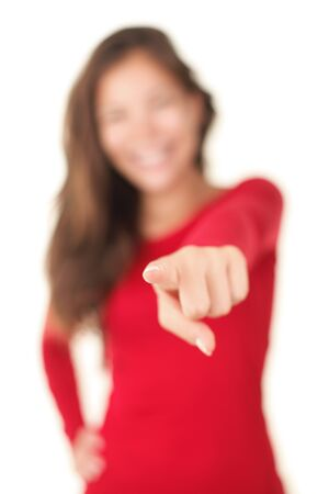 Pointing woman with very shallow depth of field, focus on finger tip. Woman in red isolated on white background.